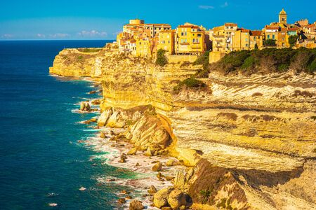 Image of Bonifacio port and Citadel in South of Corsica. Harbour and Limestone cliffs with Fortress on the very top. Breathtaking views of the French island. Stock Photo