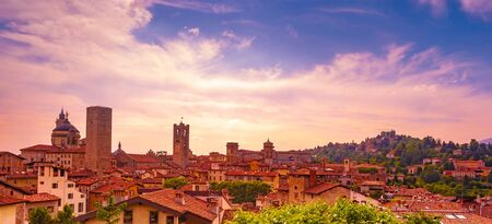 Panoramic view of the Basilica of Santa Maria Maggiore and Cappella Colleoni in Citta Alta of Bergamo, Italy on a bautiful sunset