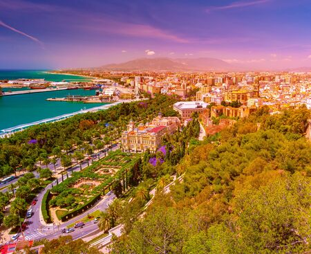 City Council Building in Malaga. Aerial view of Malaga taken from Gibralfaro castle including port of Malaga, Alcazaba castle and the Cathedral, Andalucia, Spain.