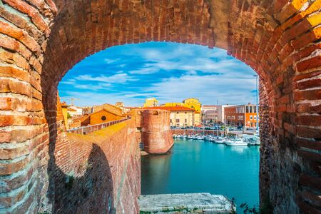 View of the landmark Fortezza Vecchia, an old fortress with a tower located in Livorno, a port city on the Ligurian Sea in Tuscany, Italy.