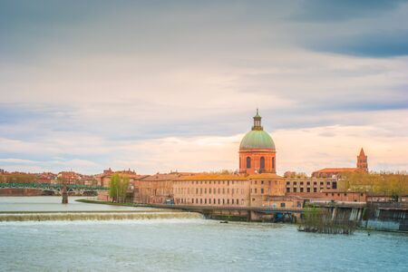 The dome of the Hopital de la Grave at dusk over the Garonne River in Toulouse