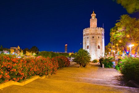 View of Golden Tower, Torre del Oro, of Seville, Andalusia, Spain over river Guadalquivir at sunset