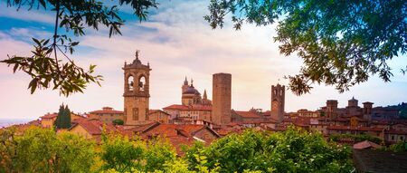 Panoramic view of the Basilica of Santa Maria Maggiore and Cappella Colleoni in Citta Alta of Bergamo, Italy on a beautiful sunset