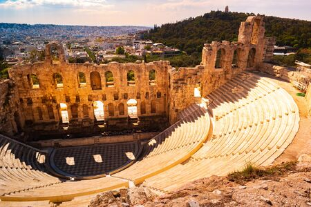 Sunset landscape with the Odeon of Herodes Atticus at the Acropolis of Athens, Greece. It is one of the main landmarks of Athens. Scenic panorama of Herod Atticus Odeon overlooking Athens city in summer.