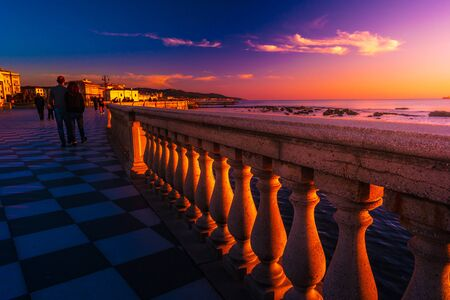Abstract patterns in singular terrace Mascagni in Livorno, Italy. Balustrade against stunning sunset with long shadows. Reklamní fotografie