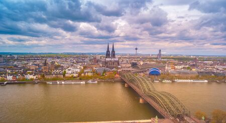 Aerial view of the cathedral in Cologne and Hohenzollern bridge over Rhein, Germany. Pictoresque view on the famous landmarks of Cologne in Germany. Stock fotó