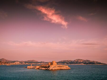 Beautiful vintage landscape with Chateau dif prison where Alexander Dumas imprisoned count Monte Cristo in his novel, Marseille, France, view from iles de Frioul.