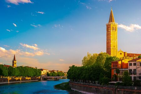 Verona, Italy. A scenic panoramic view of the river of Adige and its embankments on a cloudy and bright day