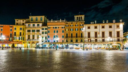 City center at night, with ancient famous buildings of the city of Verona, Italy. Gorgeous view of the famous italian city. Stock fotó