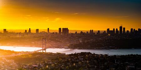 Cityscape of Istanbul with Bosphorus, skyscrapers, and 15th July Martyrs Bridge Bosphorus Bridge from Camlica hill at sunset Istanbul, Turkey Stock fotó