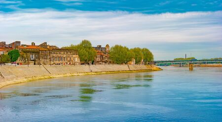 The river Rhone at Arles overlooking the old town. Buches du Rhone, Provence, France. Stock fotó