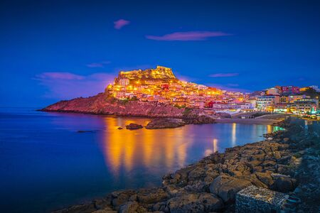 Beautiful photo of Castelsardo old cit, Sardinia, italy. Colorful photo of gorgeous italian town with colorful houses on a hill and the medieval Castle on top.