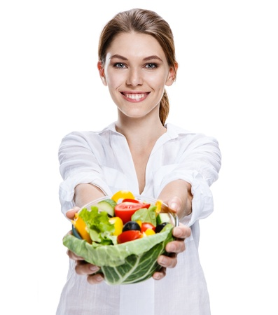 health conscious: merry european woman   vegetable salad - isolated on white background