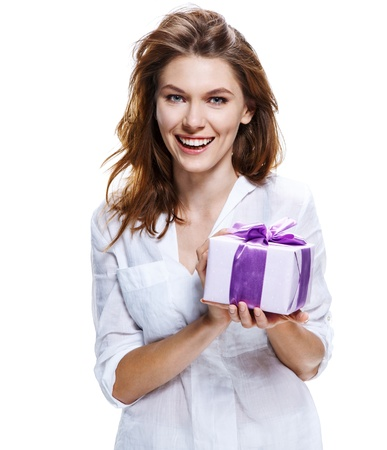life event: brunette european woman   gift-box with a bow - isolated on white background