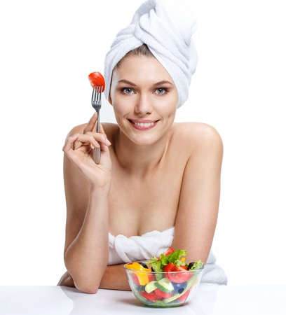 detox: european woman with vegetable salad - isolated on white background Stock Photo