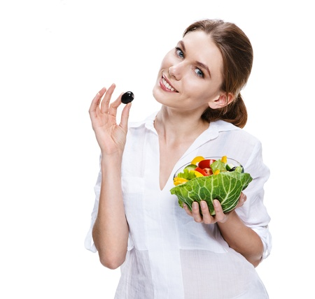 buxom european woman   vegetable salad - isolated on white background photo