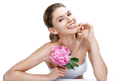 european woman with peony flower - isolated on white background photo