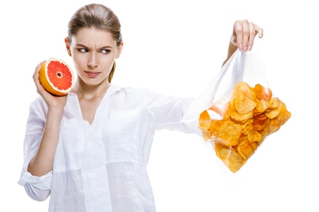 troublesome: healthy brunettes against the chips - isolated on white background Stock Photo