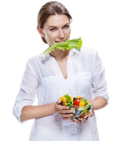 weight reduction plan: killing european woman   vegetable salad - isolated on white background Stock Photo