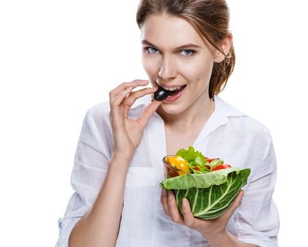 ingestion: seductive european woman   vegetable salad - isolated on white background Stock Photo