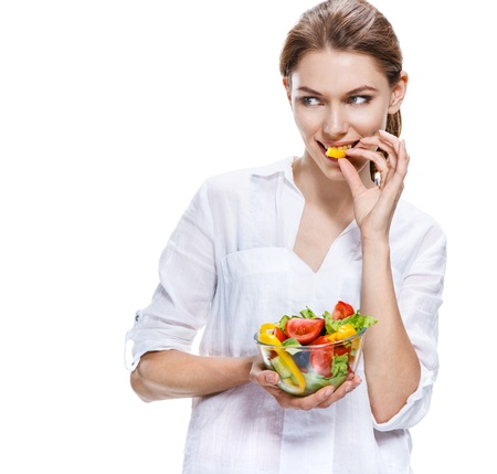 sparingly: flawless european woman   raw vegetable salad - isolated on white background