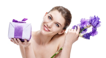 promoter: unimprovable brunette european woman with a gift-box   violet flower - isolated on white background