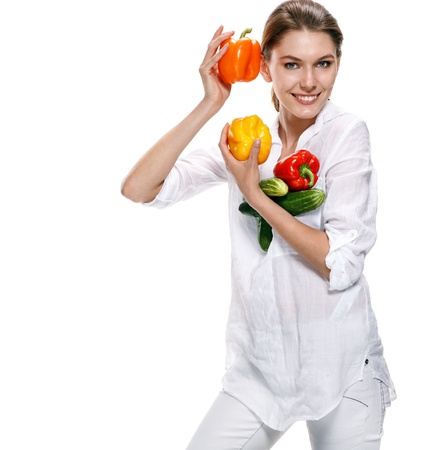 promoter: promo girl holds red and orange paprikas - isolated on white background Stock Photo