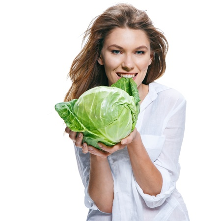 sparingly: Young beautiful woman with cabbagehead in hand isolated on white background
