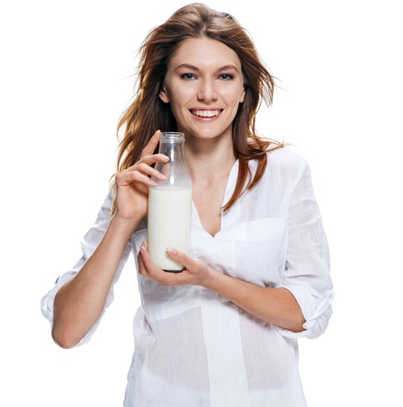 Happy beautiful woman with bottle of milk isolated on white Stock Photo - 21698721