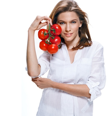 count down: Young beautiful woman with bunch of tomatoes in hand isolated on white background