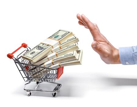 zakenman s hand winkelwagentje vol stapels dollarbiljetten - geïsoleerd op witte achtergrond