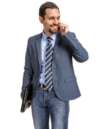 sales executive: Smiling businessman talking on the phone isolated over white background Stock Photo