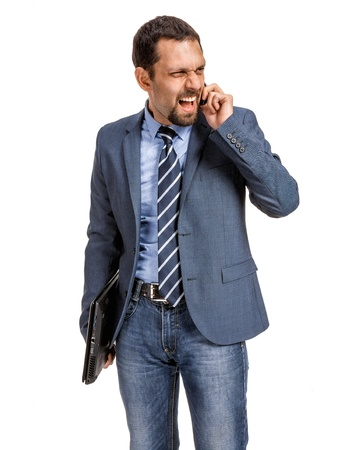 Angry businessman talking on the phone isolated over white background Stock Photo - 21645709
