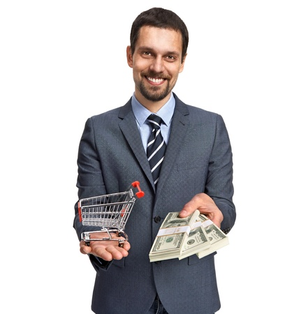 proposes: Successful businessman proposes stacks of dollar bills for shopping isolated on white background
