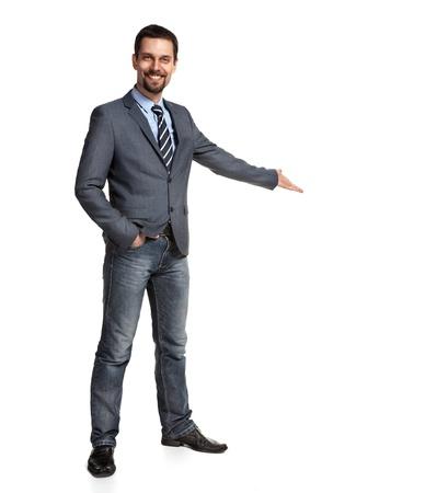 歓迎のジェスチャーは、白い背景で隔離の腕を持つ幸せなビジネスマン 写真素材