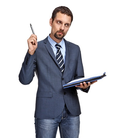 taking notes: Young business man thinking while writing notes isolated over white background