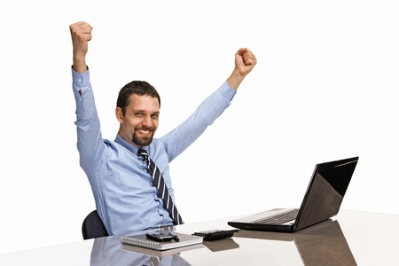 Great: businessman with his hands raised while working on laptop