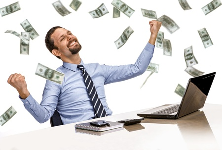guy with laptop: young modern businessman excited with his success while working with his laptop computer with money rain Stock Photo
