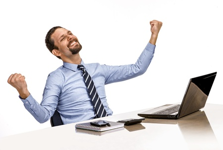 young modern businessman excited with his success while working with his laptop computer photo