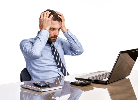 exerted: Business man in office with burnout syndrome at desk Stock Photo