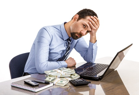 exerted: Worried businessman sitting at office desk being overloaded with work