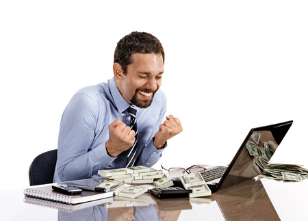 young modern businessman excited with his success while working with his laptop and accounting income photo