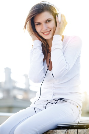 Delightful young woman listening to music photo