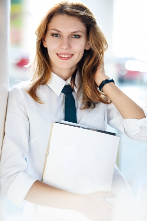 Delightful young woman holds the folder Stock Photo