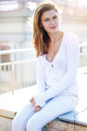 Delightful young woman just sitting photo