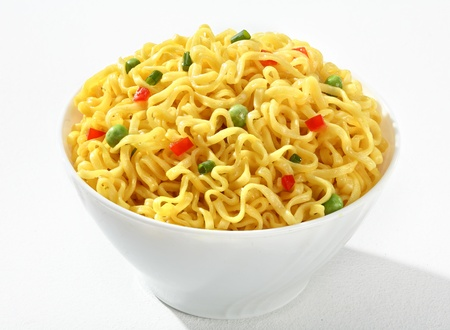 vermicelli: White bowl with cooked noodles - vermicelli with green peas and chopped bell pepper in a white bowl - on white background Stock Photo