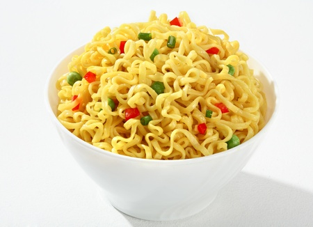 low cal: Noodle bowl - vermicelli with green peas and chopped bell pepper in a white bowl - on white background