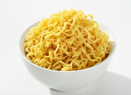 low cal: Cooked spaghetti - a portion of cooked spaghetti, served without sauce on a white ceramic bowl against a white backdrop Stock Photo