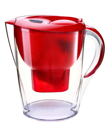 filtration: Red water filtration pitcher - domestic water purifier - closeup isolated on white background