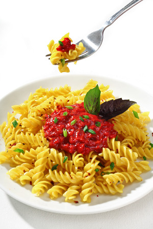short pasta: Expertly cooked macaroni with sauce skewered on a fork - baked macaroni skewered on a fork Stock Photo